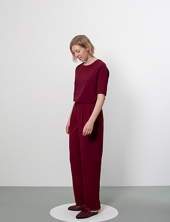 a repositioned seam . burgundy red
