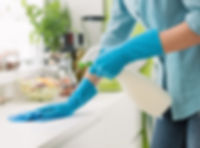 Eco-friendly home cleaning service cleaning a kitchen in West Kelowna.