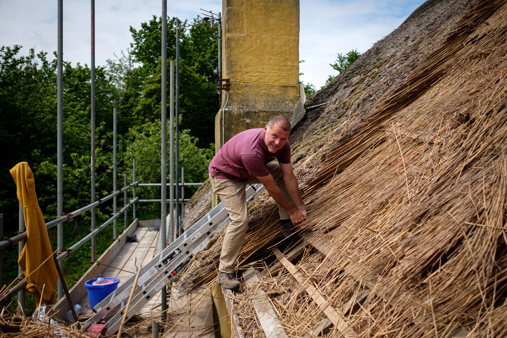 Removing old thatch