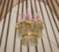 outdoor festival style wedding. Handmade chandelier in weddin yurt