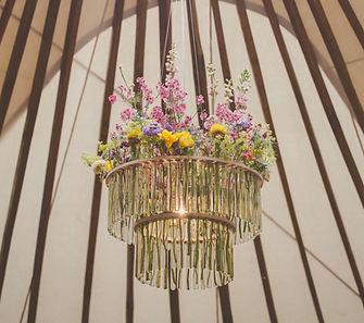 outdoor festival style wedding. Handmade chandelier in weddin yurt