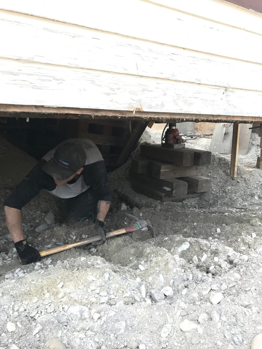 Riley beneath Dawson Lodge with his pick axe and shovel