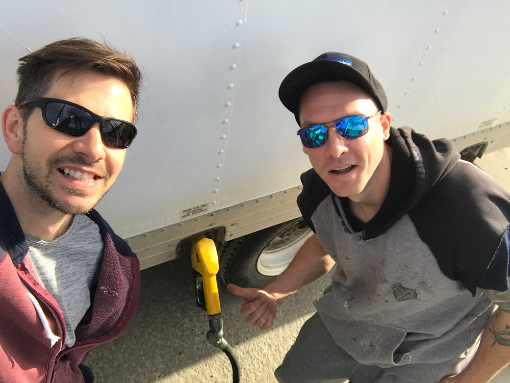 Mike and Tiley filling the truck with fuel prior to leaving to Dawson