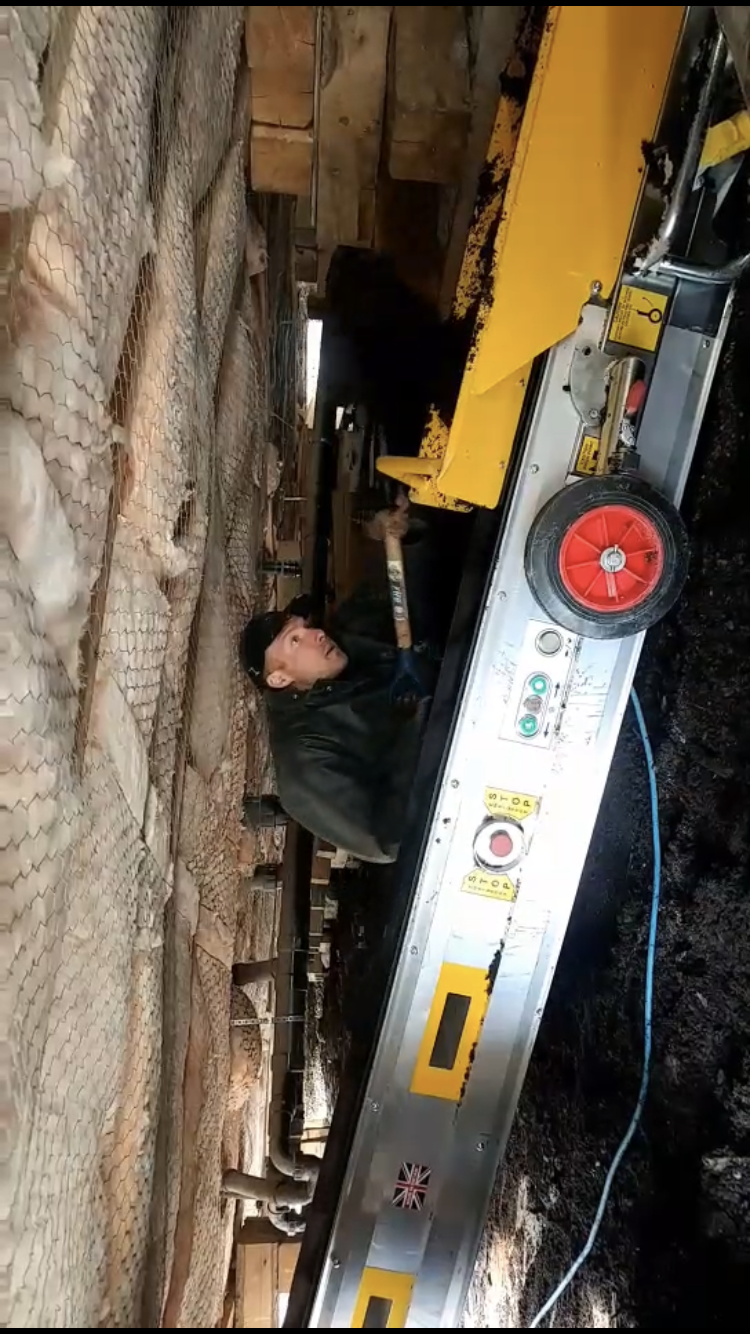 Riley and the conveyor belt, shovelling and moving lots of dirt