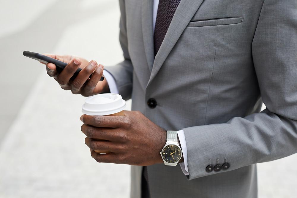 Businessman using smart software Custella for field service management.