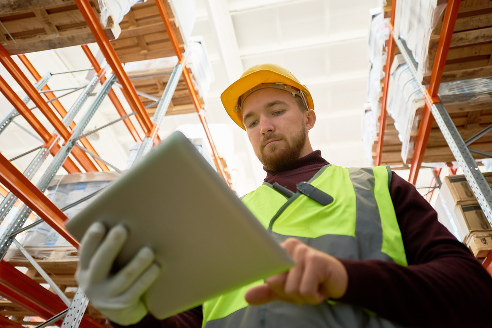 Employee using asset tracking and asset management system Custella to determine asset stock levels on the go