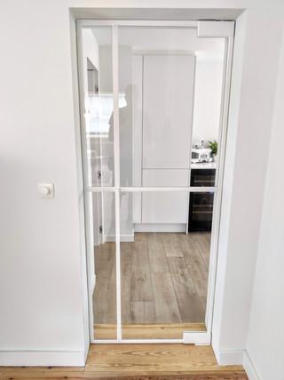 Witte steellook glazen deur