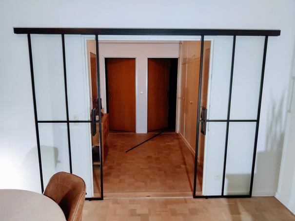 Dubbele steellook glazen schuifdeur