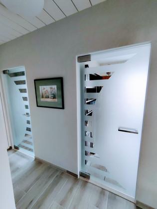 Glazen deuren met zandstraling