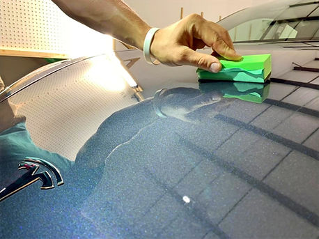 Ceramic Coating Being Applied to a Tesla