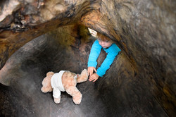 Little girl (and teddy) playing in the hollow log at Leigh Woods (c) National Trust-Alana Wright