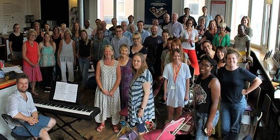 Community-Choir-group-photo-crop-940x470