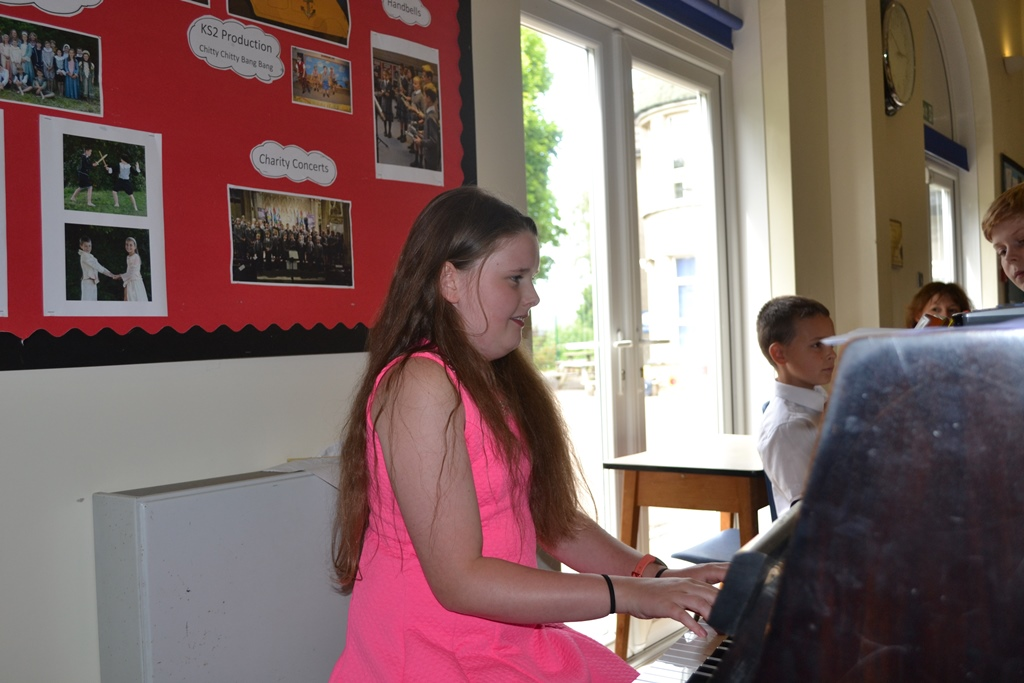 A pupil performs a piano piece