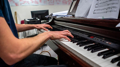 Guy Hughes playing piano in Cyrano rehea