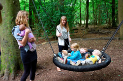 Children in basket swing at Leigh Woods 1 (c) National Trust-Alana Wright