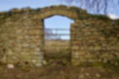 Tyntesfield boundary wall archway before