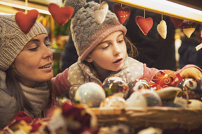 mother and daughter selecting decoration