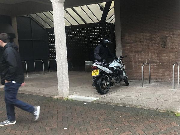 riding into precinct.JPEG