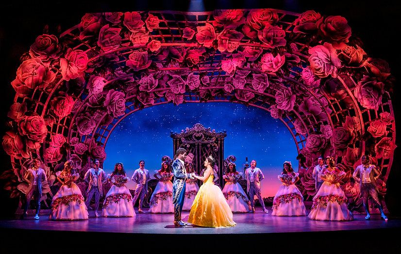 Emmanuel Kojo as Beast and Courtney Stapleton as Belle with the cast of Disney's Beauty an
