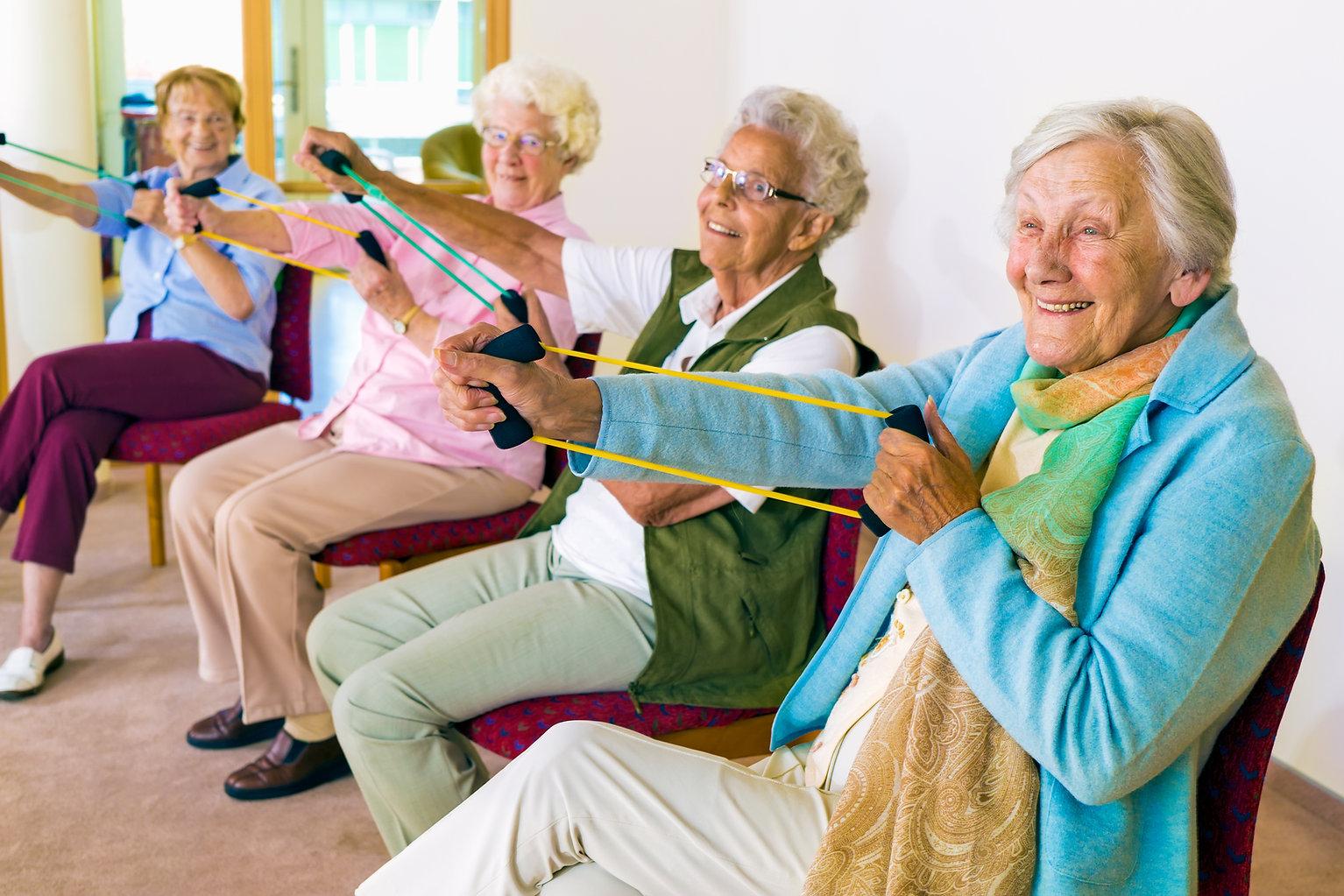 Group of four smiling senior women tonin