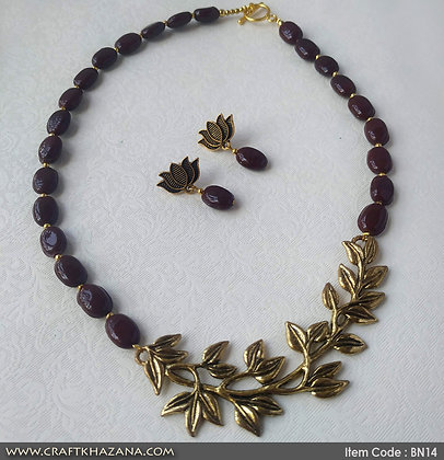 Hiral, brown and gold beaded choker necklace set with leaf pendant