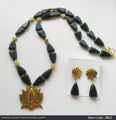 Krishne, green gold tone beaded long necklace set with lotus pendant