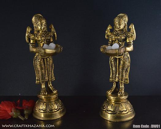 Dwija brass lady holding lamp