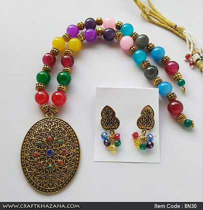Kavya, multi color beaded necklace set with gold tone pendant.