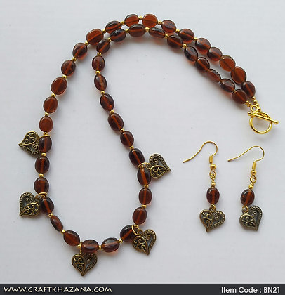 Antara, brown and gold choker necklace with leaf charms