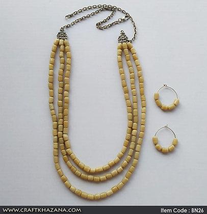Abani, three layer beige beaded necklace set