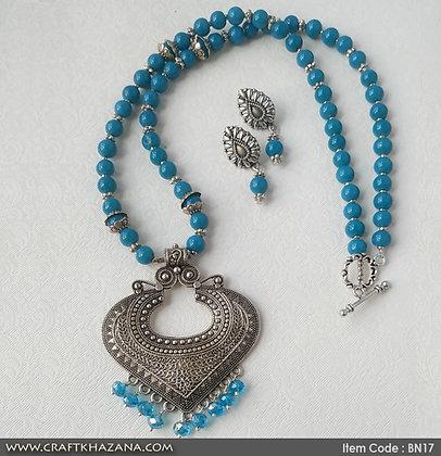 Brinda, sky blue german silver beaded necklace set