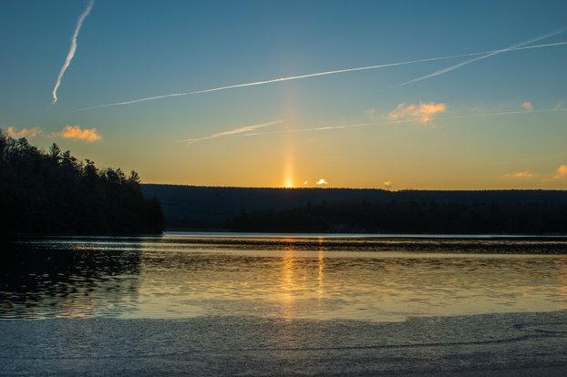 Solar pillar on the horizon