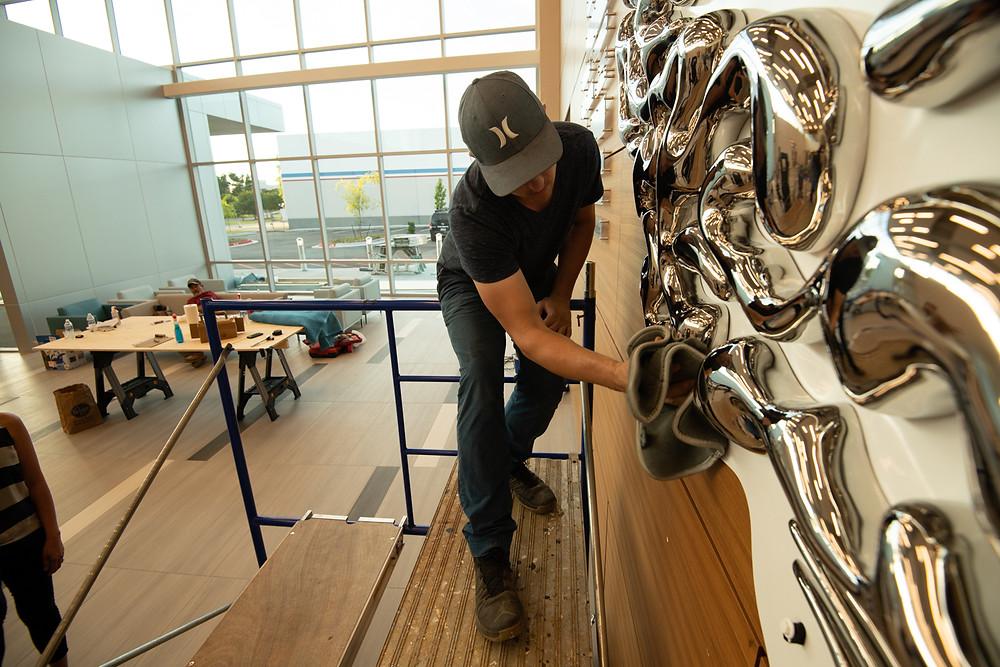 Ryan Schmidt wiping the sculpture