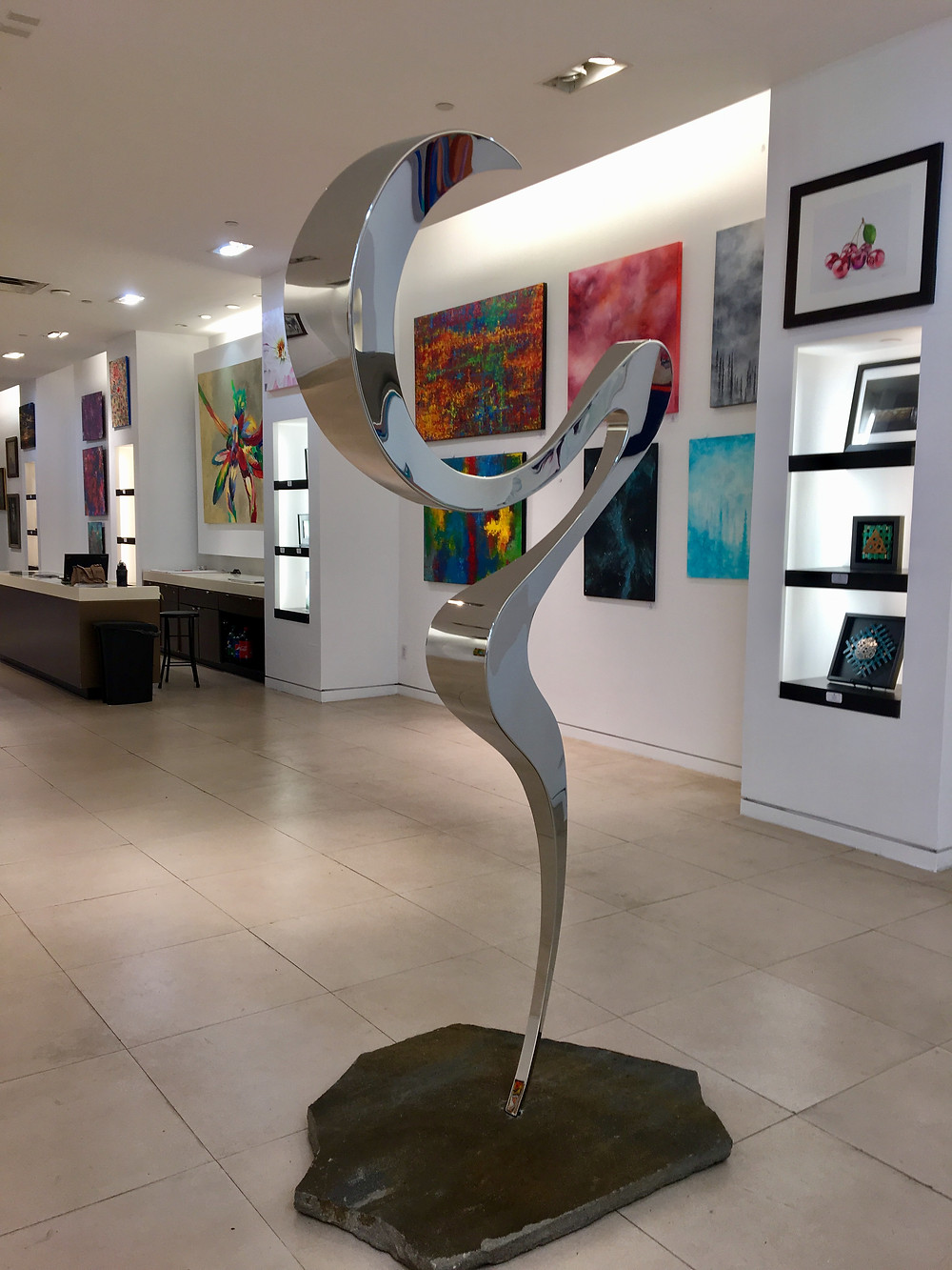 """RESURRECTION"" 7ft polished stainless steel on stone"