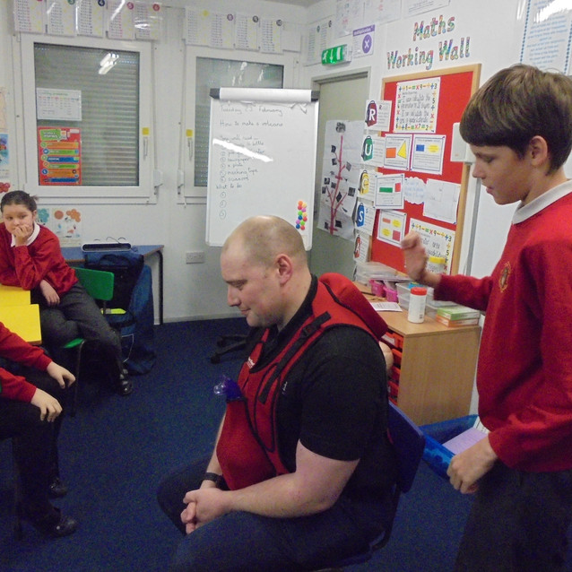 Having a go with the choking vest