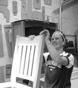 Sanding a Gustav Stickley V back chair