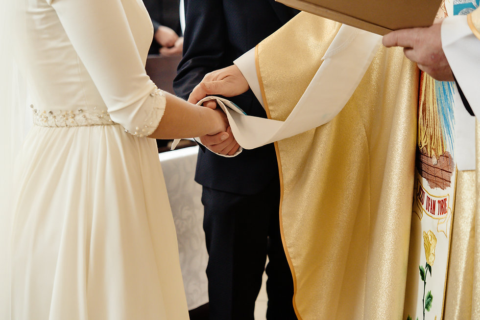 priest-holding-hands-of-stylish-bride-an
