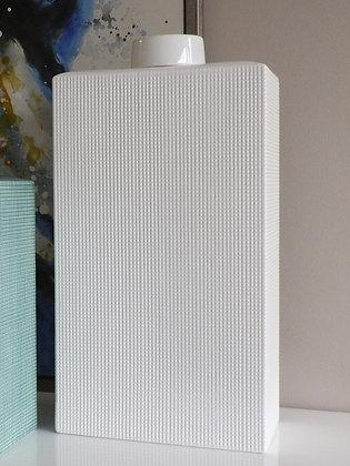 Tarro de cerámica blanco con textura