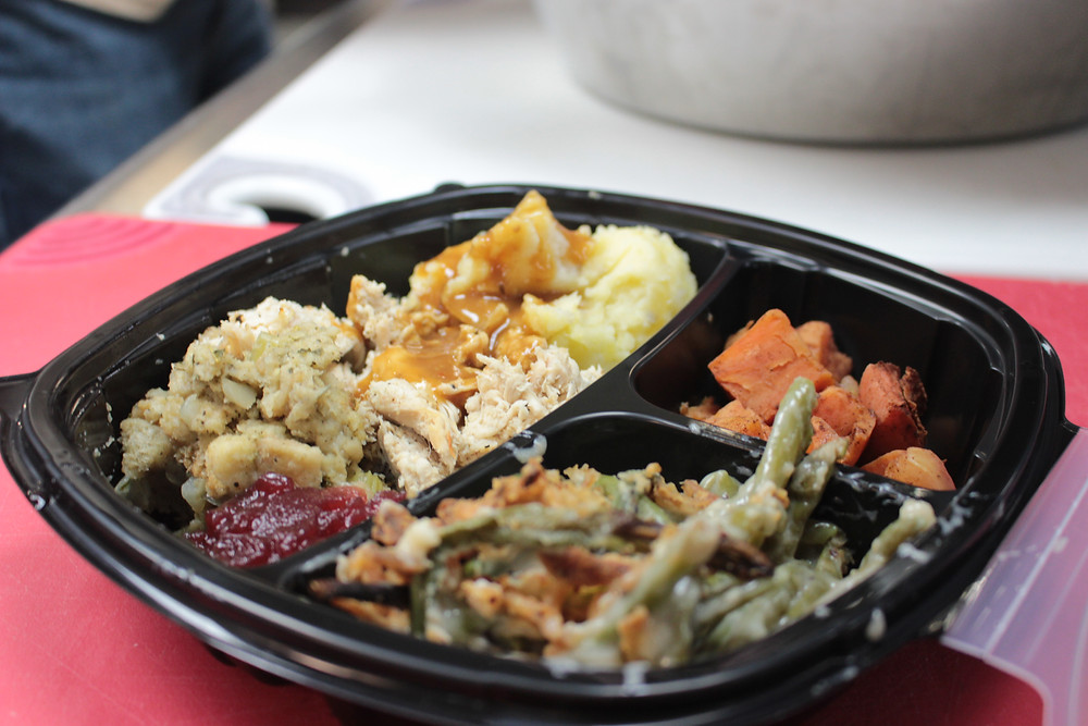 A prepared Thanksgiving meal we dispersed out to individuals for Turkeypalooza
