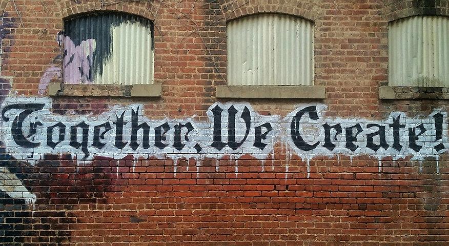"""Together, we create!"" on brick wall_edi"