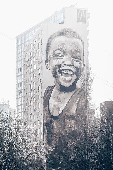 child laughing graffiti art on wall_edited.jpg