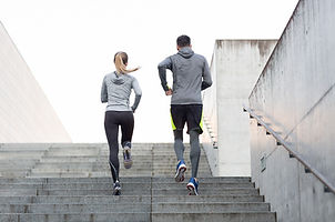 Two people exercising for health