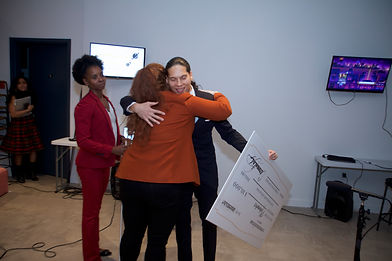 Winner hugs panel judge
