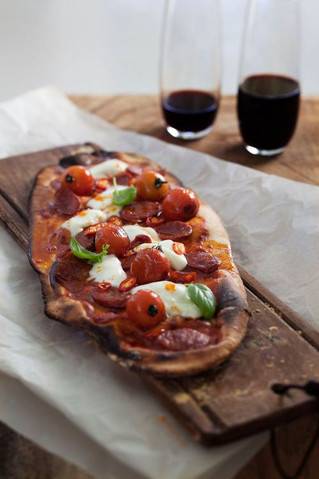 ¿Que vino argentino va mejor con mi pizza?