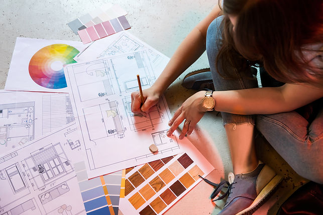 Interior designer draws plan with art to