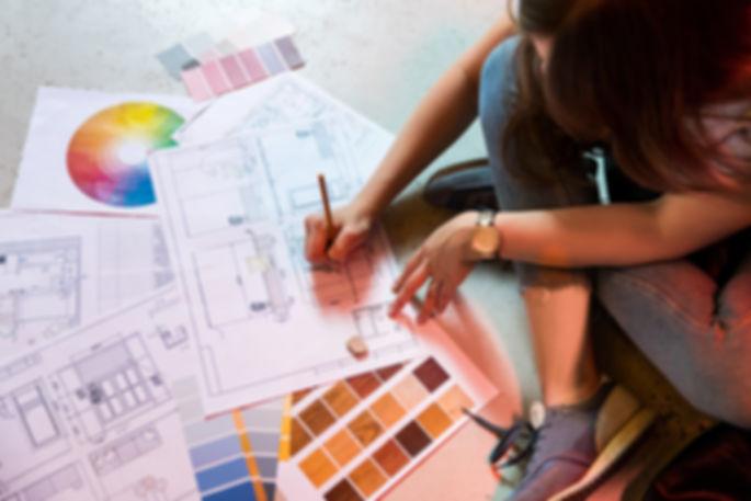 Interior designer draws plan with art to