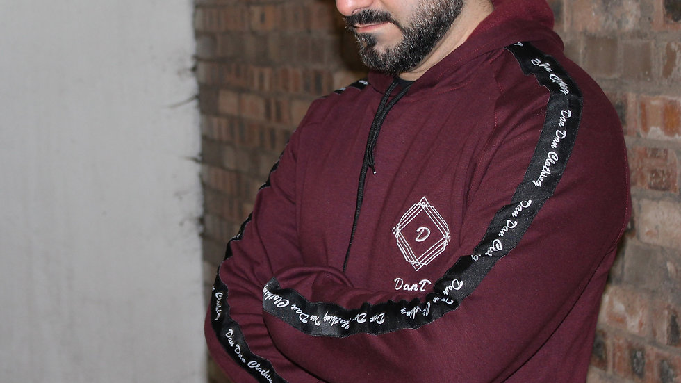 Maroon pull over hooded top.