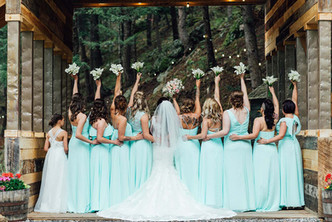 Bridesmaids on the covered bridge at Blackstone Rivers Ranch
