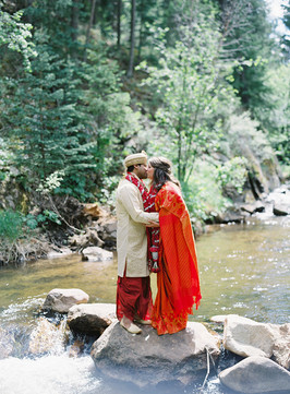 Traditional East Indian Wedding Kiss on the River at Blackstone Rivers Ranch