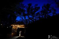 Love under the covered bridge at night at Blackstone Rivers Ranch